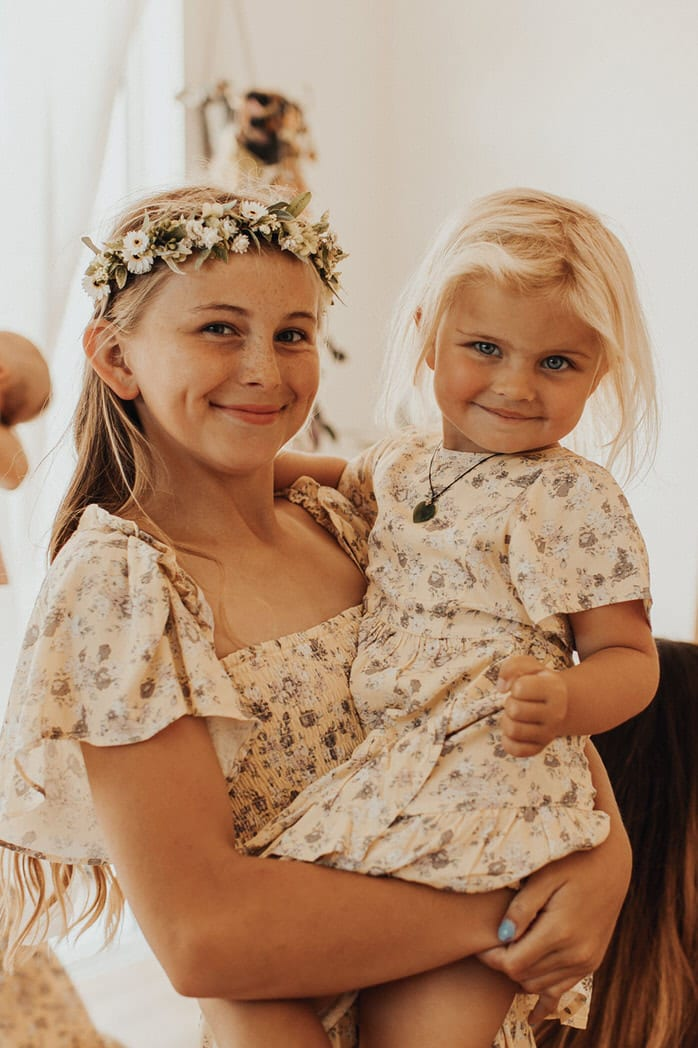 Nicole and Choppie - Gisborne Wedding captured by Oriwia Soutar. Free spirit in her Daughters of Simone gown; a seventies silhouette, fluted sleeves. Bohemian bride. Featured on Wild Hearts, New Zealand. Flower girls.