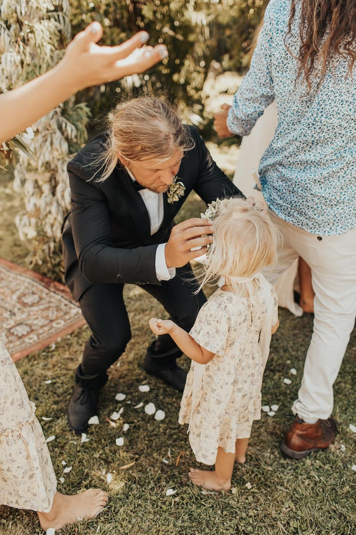 Nicole and Choppie - Gisborne Wedding captured by Oriwia Soutar. Free spirit in her Daughters of Simone gown; a seventies silhouette, fluted sleeves. Bohemian bride. Featured on Wild Hearts, New Zealand. Flower girl.