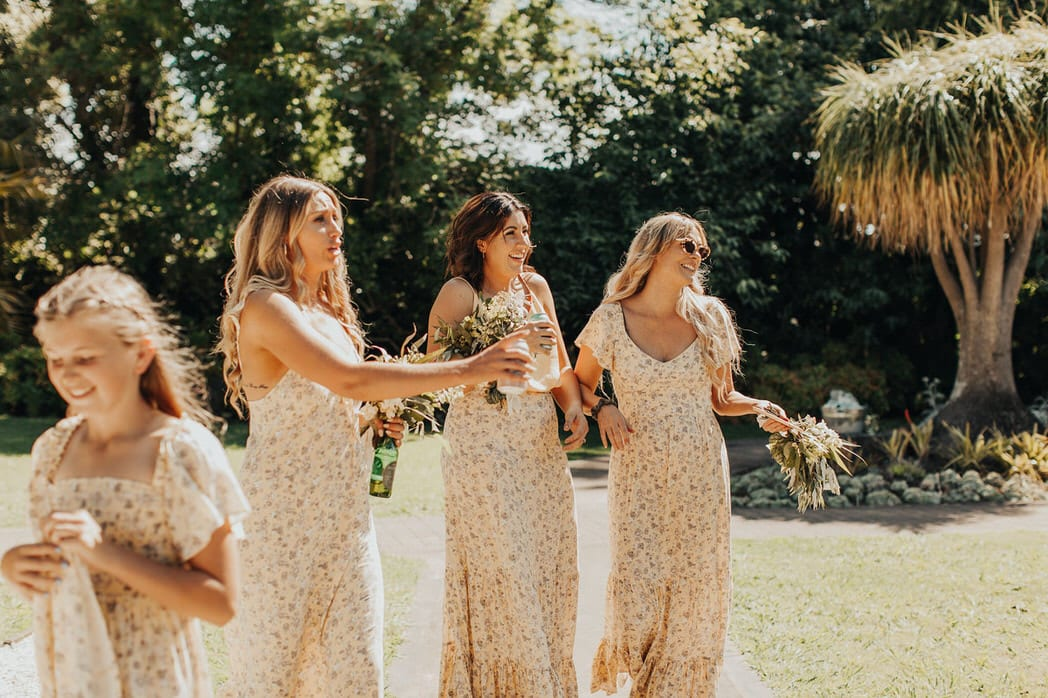 Nicole and Choppie - Gisborne Wedding captured by Oriwia Soutar. Free spirit in her Daughters of Simone gown; a seventies silhouette, fluted sleeves. Bohemian bride. Featured on Wild Hearts, New Zealand. Bridesmaids.