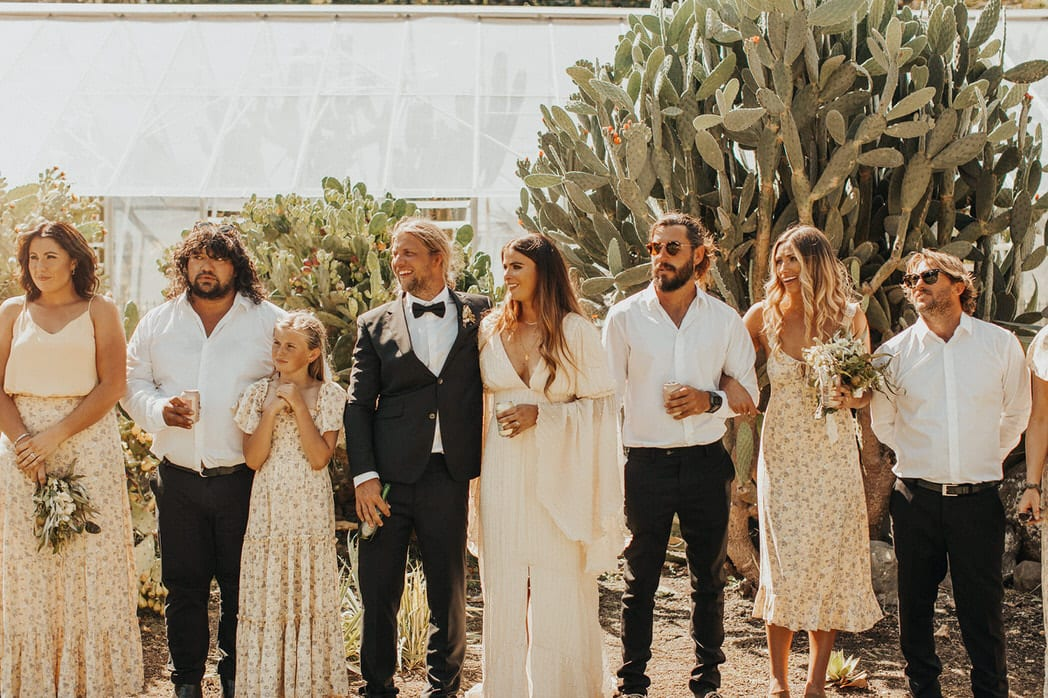 Nicole and Choppie - Gisborne Wedding captured by Oriwia Soutar. Free spirit in her Daughters of Simone gown; a seventies silhouette, fluted sleeves. Bohemian bride. Featured on Wild Hearts, New Zealand. Bridal Party.