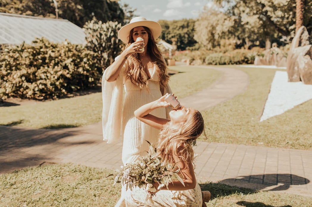 Nicole and Choppie - Gisborne Wedding captured by Oriwia Soutar. Free spirit in her Daughters of Simone gown; a seventies silhouette, fluted sleeves. Bohemian bride. Featured on Wild Hearts, New Zealand. Bridetribe.